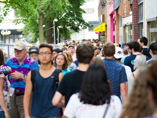Community members pass along the pedestrian mall during