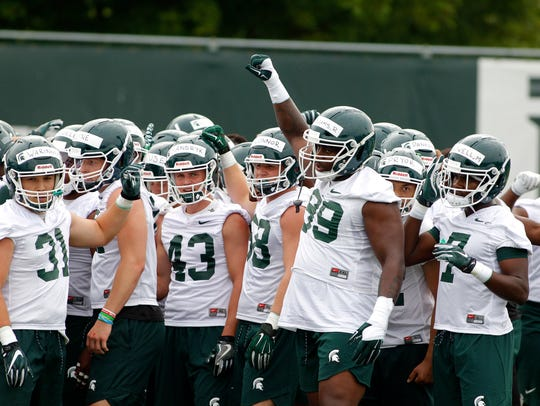 Michigan State defensive players, including Edward