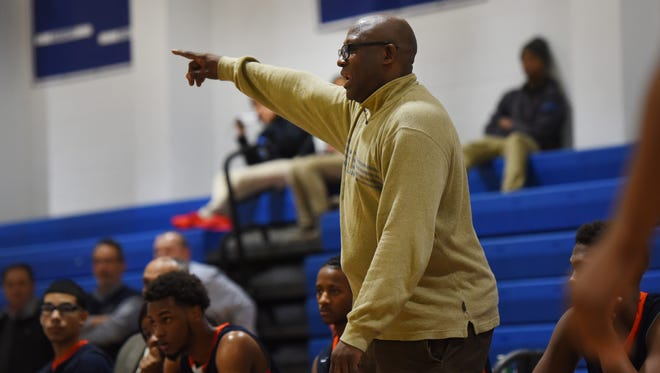 In this January 2017 file photo, Eastside coach Juan Griles gives direction to his players in a game against Passaic Tech.