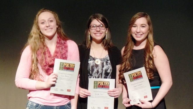 Taking the top three places at the Yerington High School Poetry Out Loud competition were, from left, Emily Bobrick, second; Gabrielle Hunt, first; and Monica Sanderson, third.