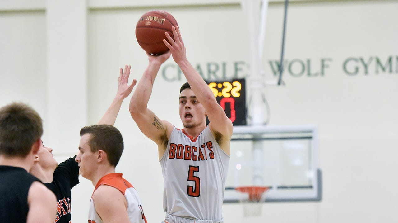 Northeastern's Antonio Rizzuto nailed a half-court buzzer beater at the end of the first half Thursday. The Bobcats went on to win, 65-62, over Central York for their second straight YAIAA title.