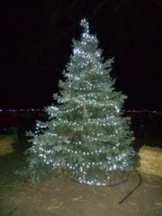 One of Dayton's two Christmas trees is shown lit at the town's Small Town Christmas Dec. 4 at Our Park.