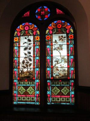 A stained-glass window with botanical motif can be seen at Tabernacle United Methodist Church (83 Main St. in Binghamton).