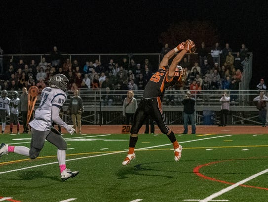 Central York's Hunter Werner (26) leaps for a catch