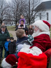 Ethan Martin, 2, talks to Santa about what he would