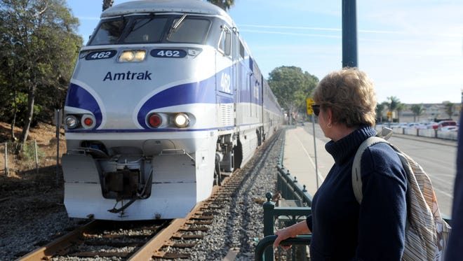 Cindy Halstead waits for the train at the Amtrak Station in the Ventura Fairgrounds because Highway 101 remains closed between Ventura and Santa Barbara. The trains have been inundated with passengers. Despite adding rail cars, the trains are selling out and standing-room-only on the ride past Montecito.