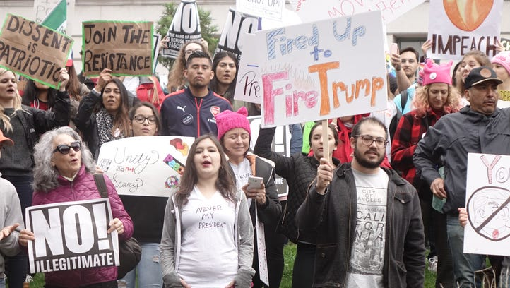 'Not my President's Day' rally in front of City Hall steps in Los Angeles, Calif. on Feb. 21, 2017.  An estimated 1,500 people were out Monday morning to protest Donald Trump with signs that said everything from 'Impeach' and 'Dump Trump,' to 'Not my President' and 'Trump is Treason.'