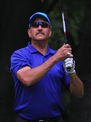Canton's Steve Wieczorek watches the flight of his ball Thursday at Fellows Creek Golf Club.