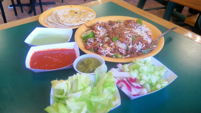 Tacos de Alambre al Pastor con Queso at Taqueria El Cometa, 9529 Viscount, are made of marinated pork served with onion, long green chile and cheese, with corn tortillas to stuff or scoop on the side. The salsa bar includes green and red chile, guacamole, cucumbers and radishes.