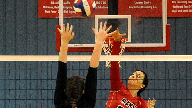 Evangel's Ashlyn Boyett attempts to block a shot during Tuesday's LHSAA Division IV volleyball playoff game.