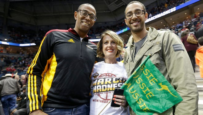 Josie Cooks, center, the mother of Winthrop basketball player Xavier Cooks, traveled all the way from Wollongong, Australia with her husband, Eric Cooks, left, and other son, Dominique Cooks, to see Xavier play against Butler in the NCAA tournament at the BMO Harris Bradley Center in Milwaukee,
