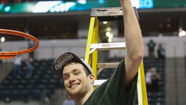 Michigan State Spartans senior Matt Costello cuts down