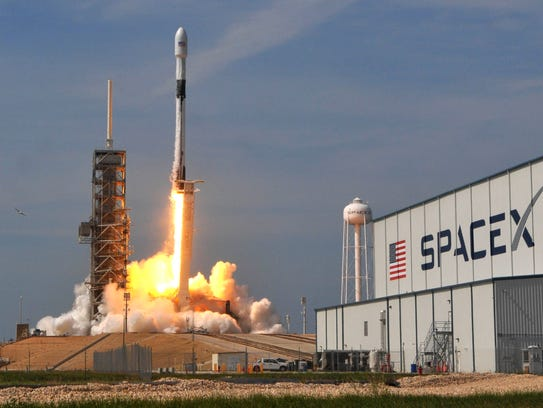 A SpaceX Falcon 9 Block 5 rocket lifts off from Pad