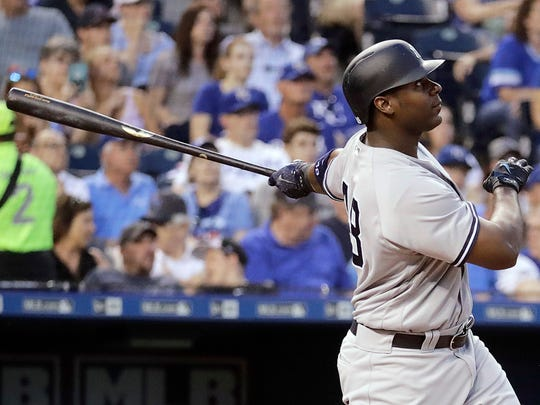 The Yankees' Chris Carter watches his two-run home run during the fourth inning of a game against the Kansas City Royals on Tuesday, May 16, 2017, in Kansas City, Mo.