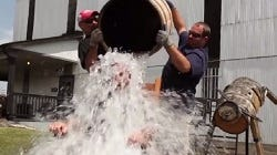 """Craig Beam of Heaven Hill Distilleries takes the """"Ice Barrel Challenge"""" in honor of his father, master distiller Parker Beam"""