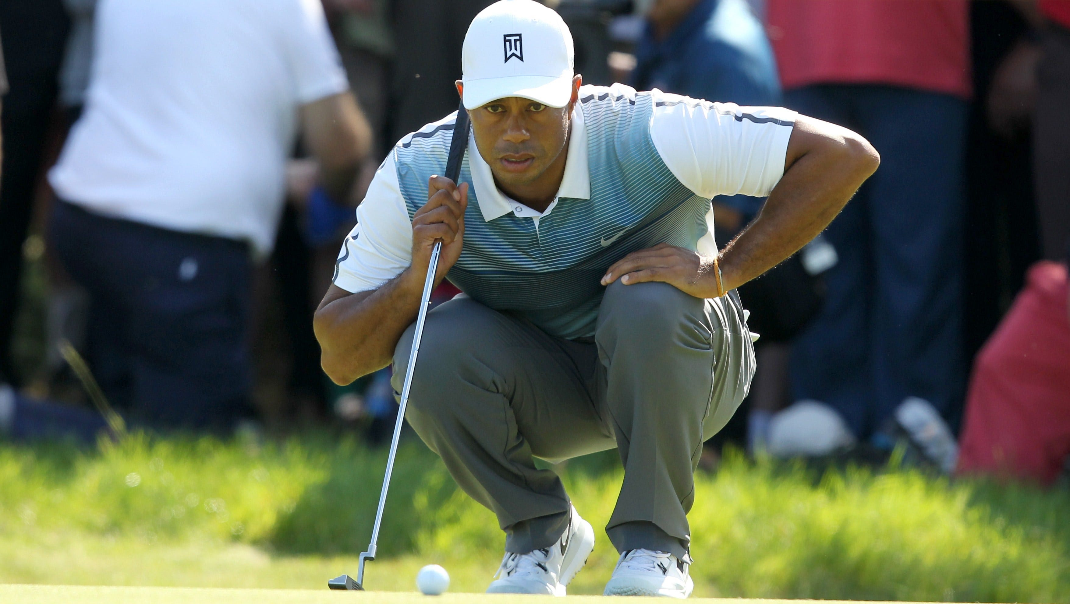 tiger woods starts slow but rolls to an opening 69 at british open