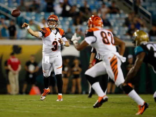 Bengals quarterback Keith Wenning throws to Antwane Grant in the fourth quarter of Sunday's preseason loss to the Jacksonville Jaguars.
