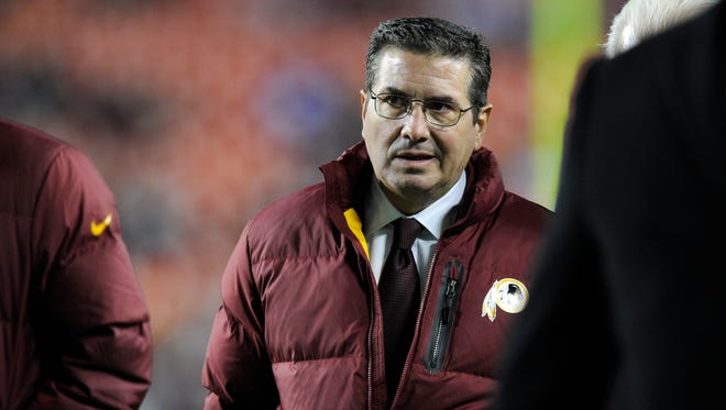 Washington Redskins owner Dan Snyder walks off the field before an NFL football game against the New York Giants on Sunday, Dec. 1, in Landover, Md.