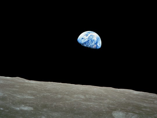"""This NASA photo shows the iconic color image of the Earth taken by the Apollo 8 astronauts on Dec. 24, 1968. The picture is known as """"Earthrise."""""""