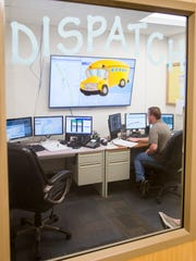 Route Manager - Danny Authement keeps his eye on monitors in the Dispatch Center at the Escambia County School District Transportation Department in Pensacola on Wednesday, July 27, 2016.