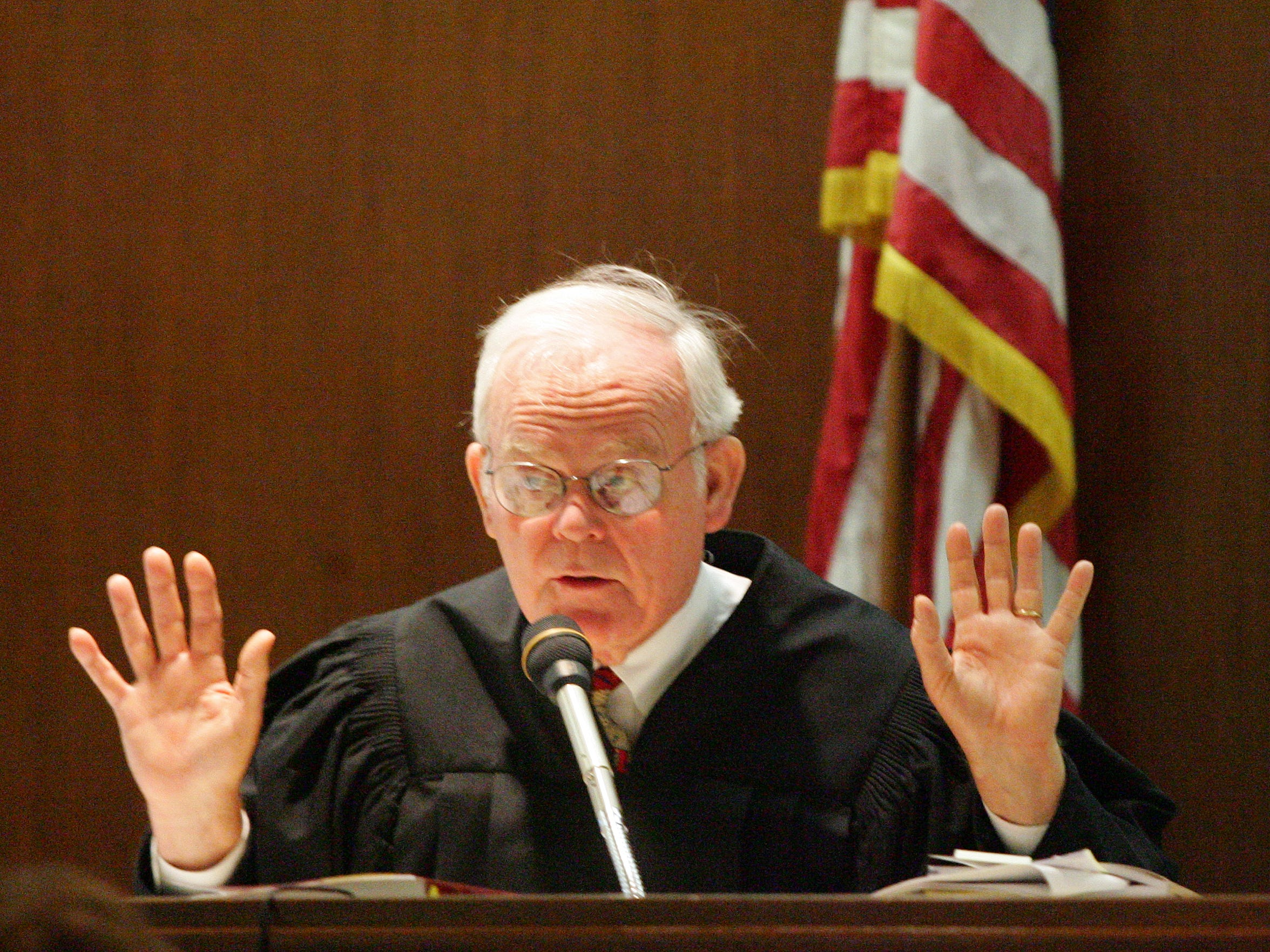 Judge David B. Downing, seen here in 2011 during the Warm Sands case, allegedly said he was unwilling to touch motions from Kaushal Niroula, an HIV positive murder defendant, because they came in licked envelopes.