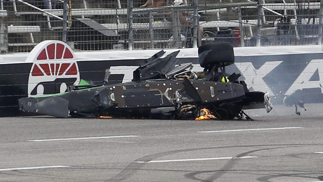 Josef Newgarden's car, left. slides down the track after being involved in a wreck with Conor Daly during an IndyCar auto race at Texas Motor Speedway on Sunday in Fort Worth, Texas.