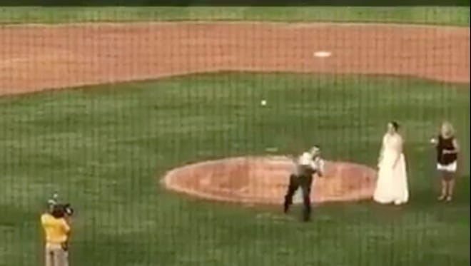 Ted Peck of York throws out a ceremonial first pitch at a York Revolution game on Saturday, Aug. 12. It was Wedding Night and Peck married Danielle Crone earlier in the night at the ballpark.