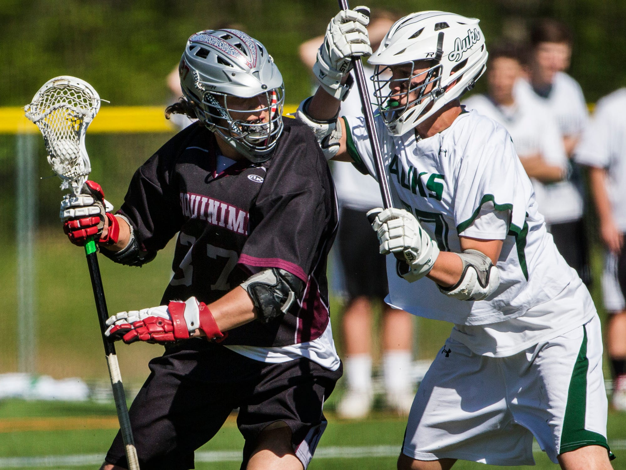 Appoquinimink's John Dunbar (left) works against Archmere's Ryan Whelan (right) in the first quarter of Appoquinimink's 13-12 win over Archmere at Archmere Academy on Wednesday afternoon.