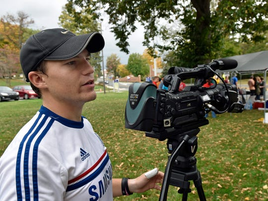 SUTV cameraman Jake Gillespie gets his gear ready to record interview during the APSCUF strike at Shippesburg University on Friday, Oct. 21, 2016.