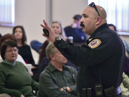 Chambersburg Police Chief Ron Camacho talks to a group