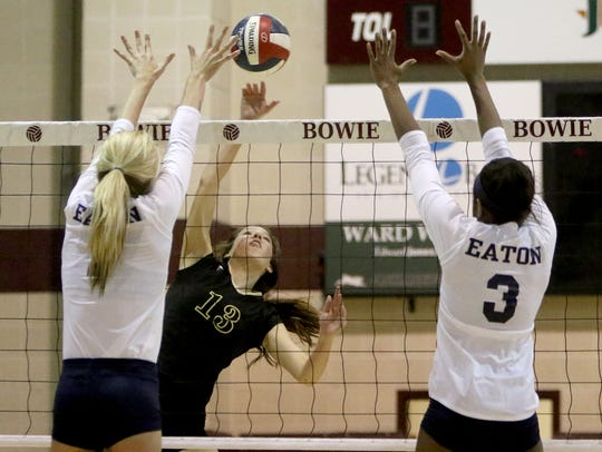 """Rider's Meredith Fisher, a senior who has signed with the University of Texas-Arlington, spikes the ball in a four-set playoff loss to Eaton. That defeat and one final chance for her group to leave a legacy has Fisher ready to tap into """"that potential we know we have"""" in 2018."""