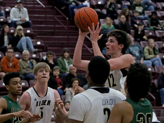Rider's Ty Caswell shoots against Bridville Friday,
