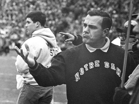 Notre Dame coach Ara Parseghian reacts and gestures after Michigan State scored in this Nov. 19, 1966 file photo in East Lansing, Mich.