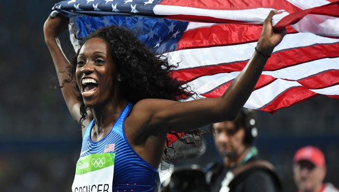 Ashley Spencer (USA) wins bronze in the women's 400m hurdles final during track and field competition in the Rio 2016 Summer Olympic Games at Estadio Olimpico Joao Havelange.