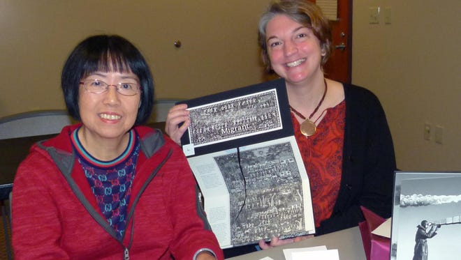 Angela Wong, left, creates her personal Journey Book under the guidance of artist Yvonne Laube, both of whom are Poughkeepsie residents.