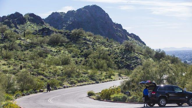People take the road leading up to Piestewa Peak.