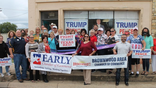Rebecca Mendoza-Pate, president of the Pecan Valley Republican Women's Club and Cheryl Jones, president of the Brown County Republican Women's Club are pictured cutting the ribbon, standing together in support with Robert Porter, Chairman of the Brown County Republican Chair.