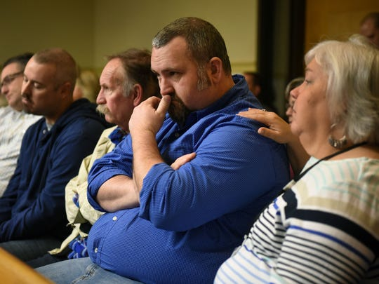 Joshua Hurst, an ex-Knoxville police officer, sits with family members waiting on hearing to start where he and six of his seven co-defendants accepted pleas in a conspiracy to distribute prescription painkillers Friday, Mar. 10, 2017. Hurst, 39, a 13-year veteran of the Knoxville Police Department, stole and sold drugs while on duty and in his cruiser.