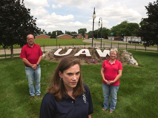UAW Local 5960 member Jennifer Sanders poses for a photo with her parents, Roy Richard of Burton and Kris Richard, both former UAW members, at the Sitdown Strike Memorial on the grounds of the UAW Region 1C in Flint.