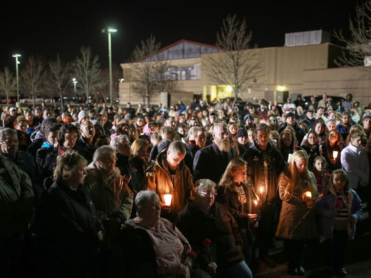Family members stand in the front as people gather for a community prayer vigil on Thursday, Dec. 10, 2015, for 7-year-old Emma Watson Nowling.
