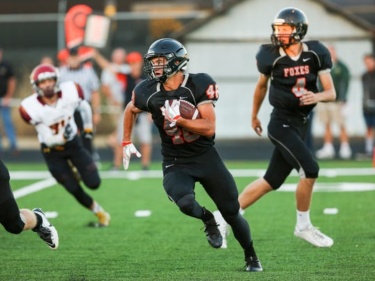 Silverton's Austin Haskett (48) carries the ball after a handoff from quarterback Levi Nielsen (4) in a game against Redmond on Friday, Sept. 9, 2016, at Silverton High School.