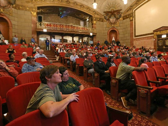 Attendees listen during a question-and-answer portion at the end of an informational meeting with Veterans Affairs officials about the plans for a military cemetery at Crown Hill, held at the Indiana War Memorial, Indianapolis, Ind., Thursday, September 29, 2016.