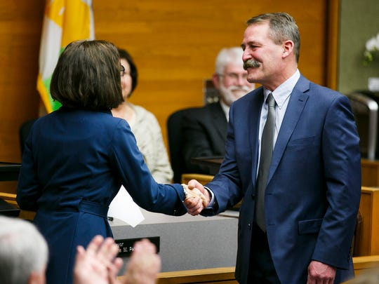 Ward 3 councilor Brad Nanke shakes hands with Gov. Kate Brown after being sworn in for another term on Wednesday, Jan. 4, 2017, at Salem City Hall.