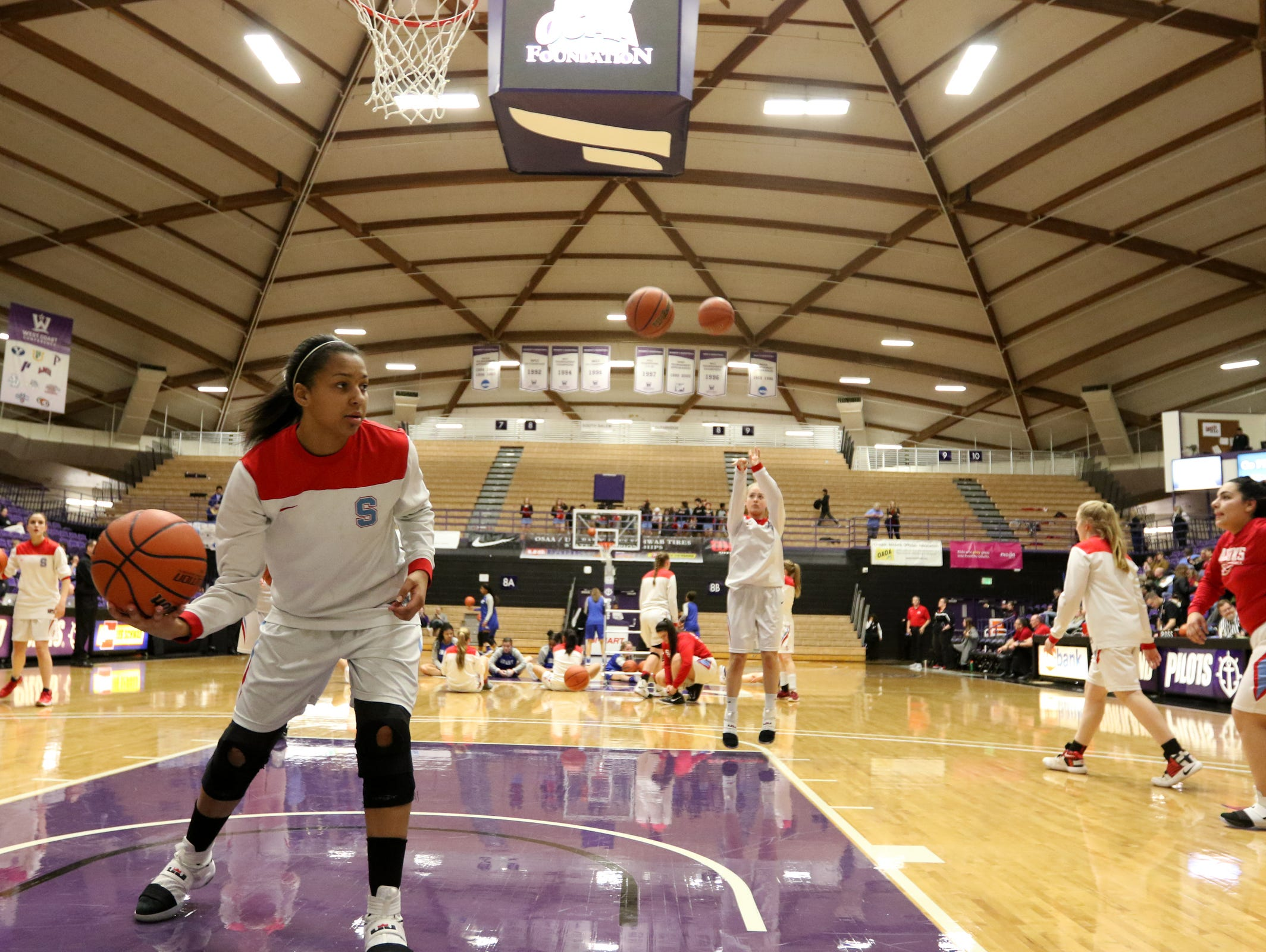 South Salem warms up before the Grant vs. South Salem girl's basketball game to determine third place in the OSAA Class 6A State Championships at the University of Portland on Saturday, March 11, 2017. South Salem won the game 58-53.