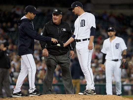 Jun 6, 2017; Detroit, MI, USA; Tigers manager Brad Ausmus takes the ball to relieve relief pitcher Blaine Hardy in front of umpire Joe West in the seventh inning against the Angels at Comerica Park.