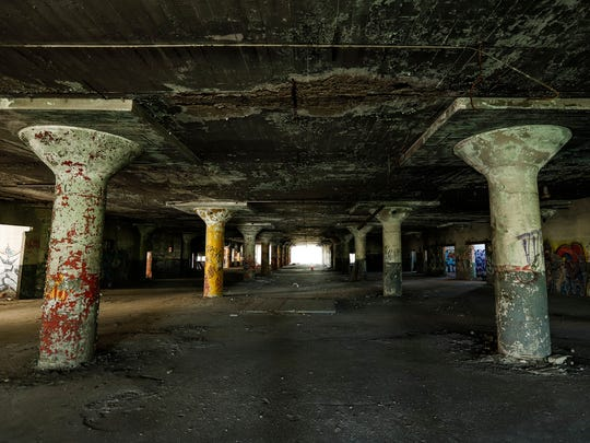 The guided tour visits the parking garage of the Packard Plant, Sunday, September 24, 2017 in Detroit.