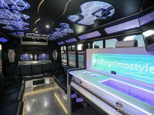 The party-ready interior of a spooky party bus available from Indy Grimo, seen in Indianapolis, Monday, Oct. 9, 2017. At right, a youth-sized casket has been turned into a bar. Indy Grimo offers year-round rides in two hearses and a party bus. Halloween is the business's busiest time of year.