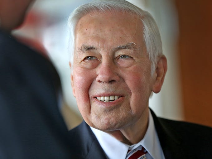Richard Lugar smiles while talking with Bart Peterson,