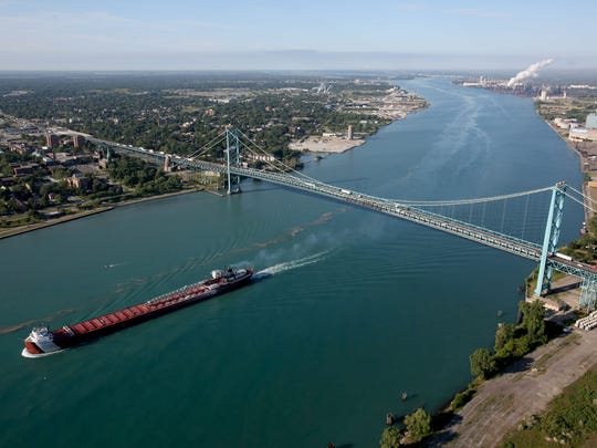 A freighter is upbound on the Detroit River after passing