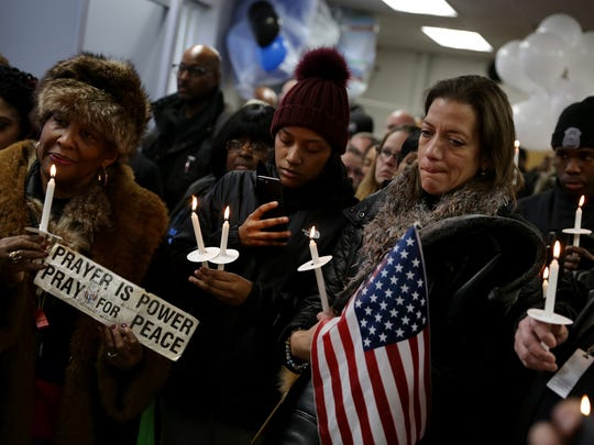 A candlelight vigil was held for fallen Detroit Police